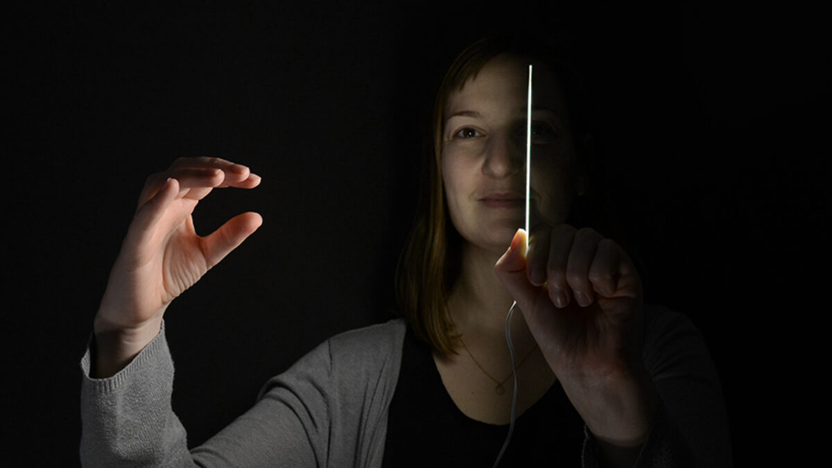 Woman holding OLED panel