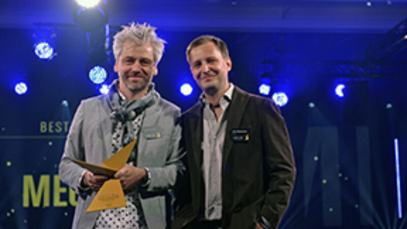 Valentin Spiess and Reto Weljatschek holding XAVER award