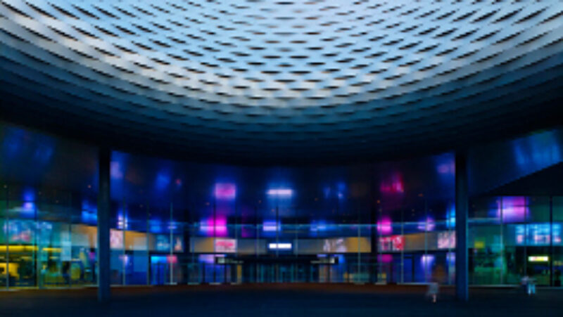 foyer of messe basel with led screens