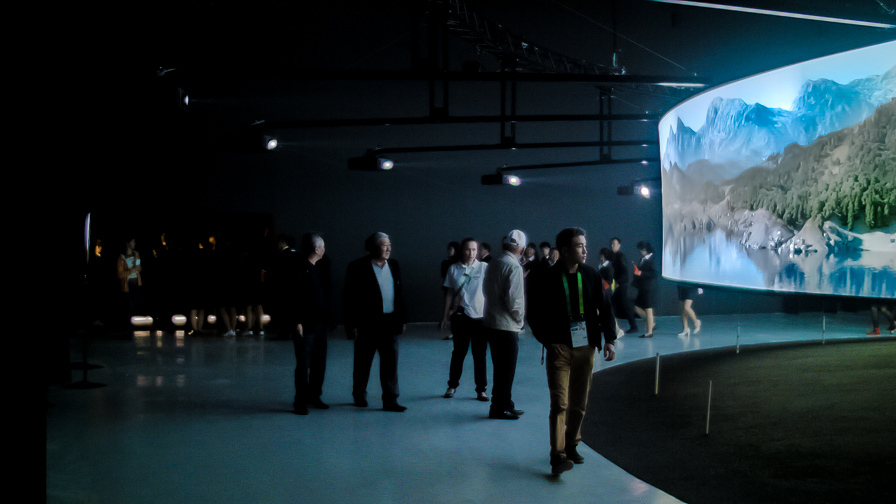 visitors in front of light installation