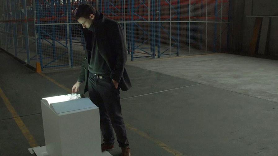 Man looking at interactive book