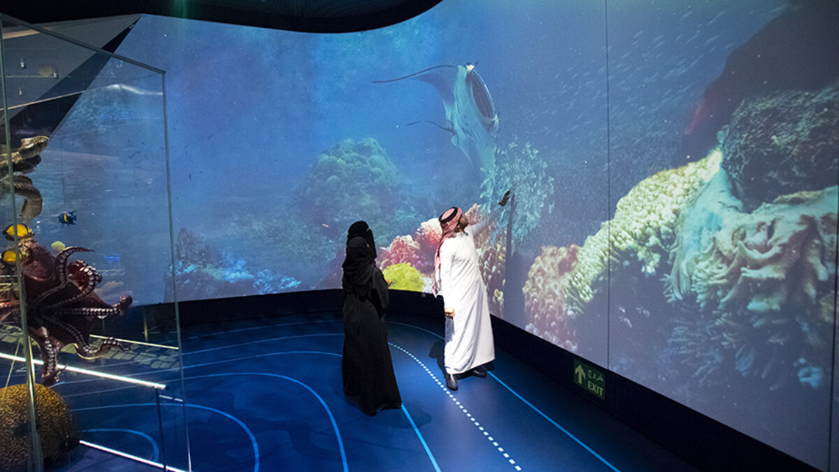 Ithra Dhahran Arabian Journeys Huge Three Visitors In Front of an Interactive Projection